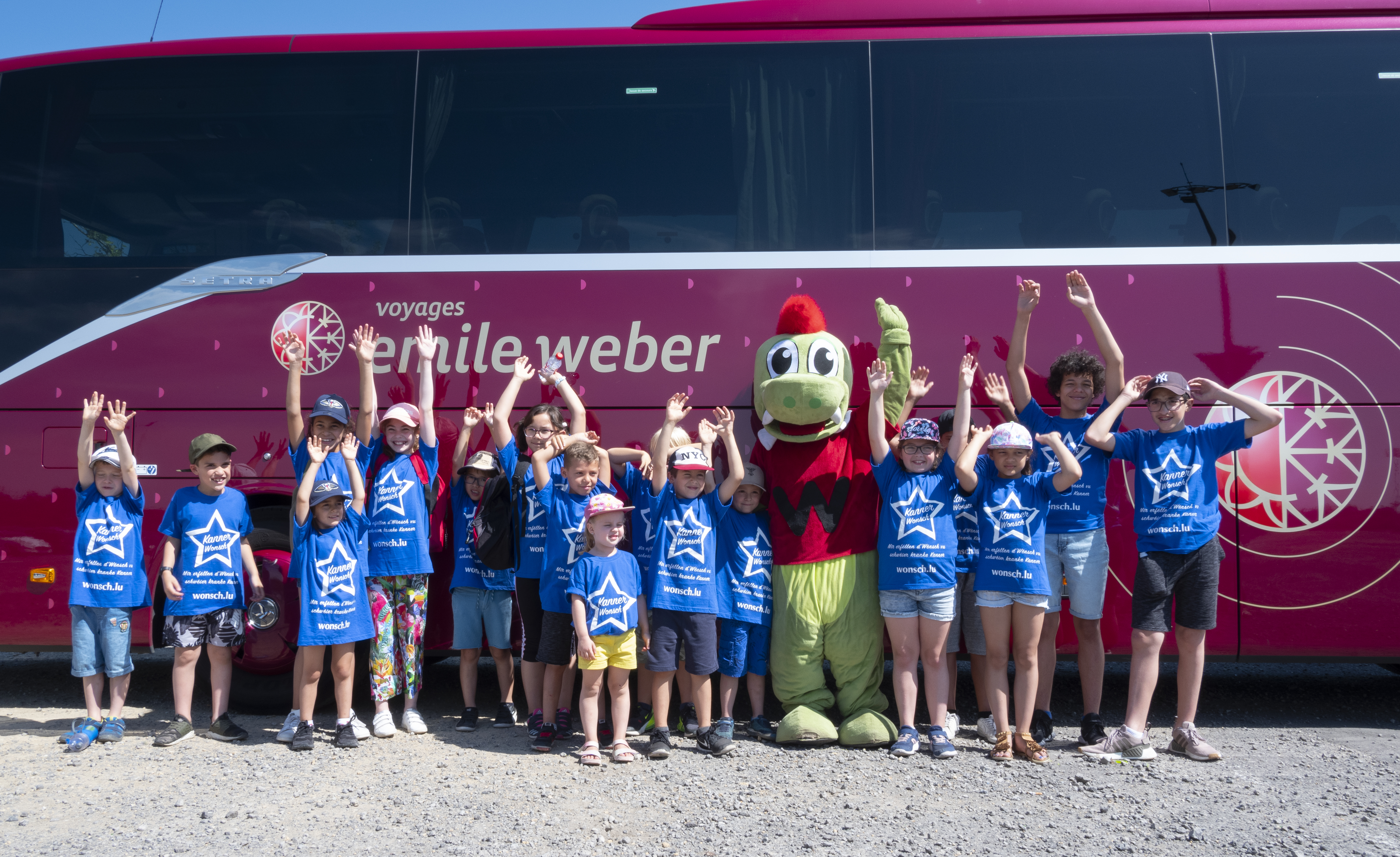 Group in front of Emile Weber bus